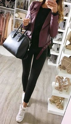 Colored leather jacket + black shirt + black leggings / skinny jeans + white sneakers