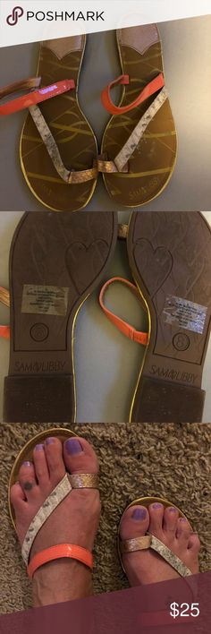 Sam and Libby sandals Great Sam and Libby sandals in a tan base with a thong section for the toe with a snakeskin look with coral peach color tones great for the summer and goes with everything worn once so comfy size 8 my feet shrunk after I lost weight!!! Sam & Libby Shoes Sandals