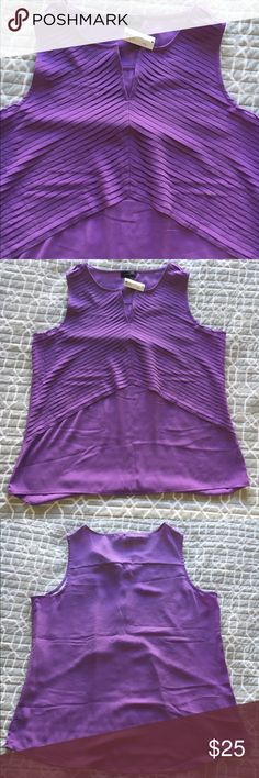"""The Limited Purple Split Neck Sleeveless Shell Adorable sleeveless shell perfect for spring and summer.  Vibrant shade of purple with delicate folds giving the impression of texture.  NWT, Size L.  ·         Chest is 44"""", Length is 25""""  ·         Material is 100% Polyester  ·         Machine wash cold; lay flat to dry The Limited Tops Blouses"""