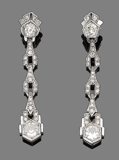 A pair of art deco diamond pendent earrings, circa 1925  Of tapering geometric design set throughout with single and old brilliant-cut diamonds, diamonds approx. 1.90cts total, length 4.7cm