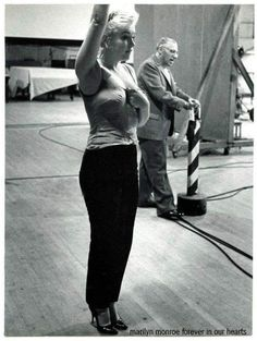 Marilyn Monroe rehearsing with George Kukor for Let's Make Love, 1960.