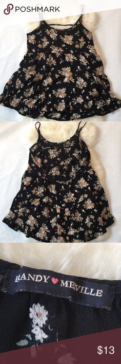 Brandy Melville black floral open back tank OS In good condition except for a small cut under the arm that has a bit of string sticking out. One size Brandy Melville Tops