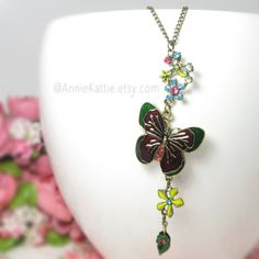 Butterfly necklace Flower necklace Garden necklace by AnnieKattie Red Necklace, Butterfly Necklace, Flower Necklace, Delicate Gold Necklace, Maroon Color, Blue Yellow, Annie, Etsy Shop, Group