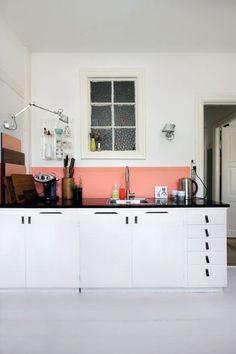 Salmon pink backsplash in the kitchen of visual merchandiser Anne Mette Skodborg Jensen and product specialist Steffen Brodersen Martiena