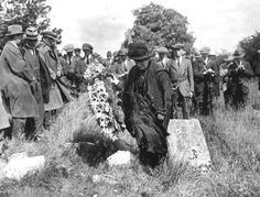 Margaret Pearse laying a wreath on the graves of sons Padraic and Willie Pearse at Arbour Hill 1916.(Pre landscaping).
