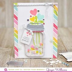 A gorgeous and easy shaker card perfect for Mother's day or any other occasion! Turn a mason jar into a shaker vase holding beautiful pink, blue, and yellow stamped heart flowers the fast and easy way! Queen and Company, Love Jar Kit Ginger Williams