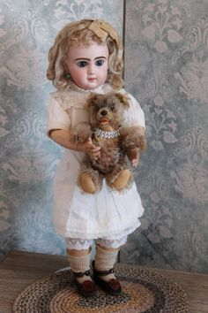 French Bisque Bebe Jumeau Tete Model, size 8. original chemise wig corset and shoes.