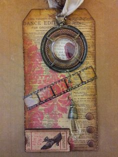 MME paper tag,  Tim Holtz film strip, distress inks, copper Brads, recollections vintage ticket, and industrial chic embellishment.  Created by Diane K