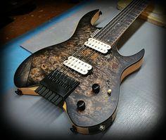 Kiesel Guitars Carvin Guitars  Special custom V7 Vader headless series by Jeff Kiesel. Soecial custom finish over a burl maple top and Kiesel treated fretboard