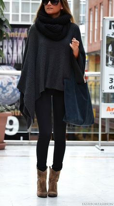 black leggings, dark gray sweater poncho, black wool infinity scarf, off color ankle boots, and black sunglasses.