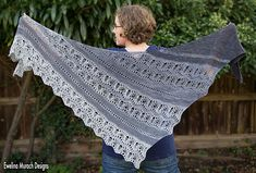 Stormy Monday is a triangular, bias knit shawl in five shades of grey - from soft light grey to charcoal. You start knitting from the lace edge on the left side, gradually decrease stitches at the top edge forming a triangle, and end with just two stitches at the right tip.