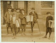"""Some of the boys at a busy trolley junction - Pictures of Child Labour (early 1900's) In USA by Lewis Hine. Brothers, Salvatore, 9 yrs. (in front), Joseph, 11 yrs. (cripple), Lewis, 13 yrs. (between these 2). """"We would be murdered if we shop craps."""" Boy at left sold me pair of dice for 2 c[en]ts. – what he would have to pay for more. Location: Jersey City, New Jersey."""