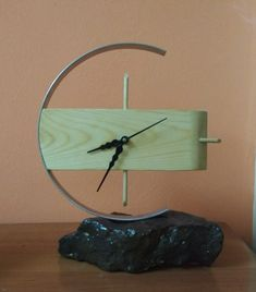 My first Table Top Clock madeup by combination of stone, wood and steel.