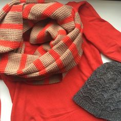 J. Crew chunky knit striped scarf I love this chunky knit scarf. The colors are so perfect! It's a caramel color and an orange color. It's in great condition! J. Crew Accessories Scarves & Wraps