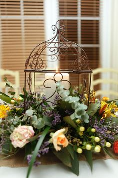 I've seen several birdcage arrangements, but I love the way this one is done!