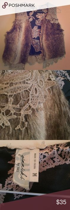 Gimmicks by BKE faux fur and lace vest. Adorable! Super cute and trendy. EUC. There is a bit of fraying in the lace but it looks like it goes with the style of the vest. Jackets & Coats Vests