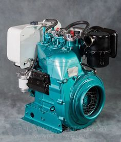 A Ducati industrial diesel engine from the 1970's.  864cc, 22hp.  For the love of motorcycles, please, someone put one of these in a trellis frame.