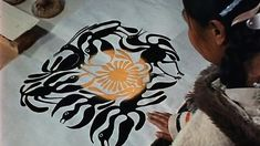 This documentary shows how an Inuit artist's drawings are transferred to stone, printed and sold. Kenojuak Ashevak became the first woman involved with the printmaking co-operative in Cape ...