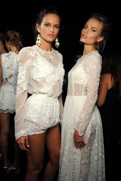Izabel Goulart & Natasha Poly backstage at Dolce & Gabbana Spring/Summer 2011 RTW at Milan Fashion Week.