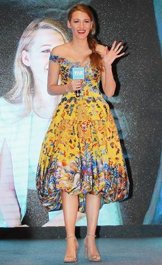 Blake Lively wears an off-the-shoulder printed Laurence Xu dress, and Stuart Weitzman sandals