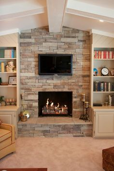 Superb Design Of The Stack Stone Fireplace With White Wooden Bookshelf  Added With Beige Fabric Sofa