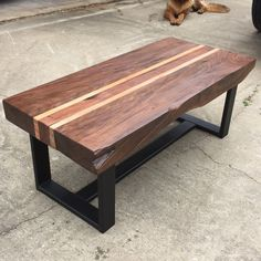 Almost 4 inches thick, this coffee table is full of character. Solid walnut with maple accents, slabs like these are very rare. Welded steel base,...