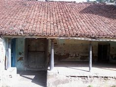 This is an old house in a remote village in the state of Tamil Nadu in Southern India. Back when my husband's grandparents lived in the village, each caste (sect) lived on its own street. This house is on the brahmin street. Many of the brahmins left and this street is the most deserted in the village. They left for Chennai or other cities.  I'm looking at the decorative elements like columns, carvings. And, colors and textures.
