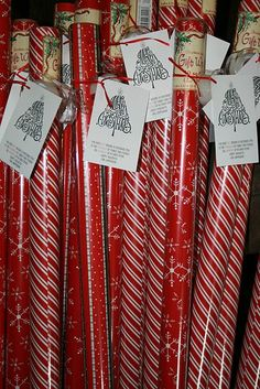 "Cute (and inexpensive) idea to give as neighbor gifts...  The tag says: ""The best GIFT around a Christmas Tree is the PRESENCE of family and friends, all WRAPPED up in each other.""  Or: ""Wrap Yourself in the Holiday Spirit."""