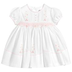 Girls white traditional heritage style dress by Sarah Louise. Made in a double layer of soft polycotton, with pink hand-smocking and hand-embroidery. It has embroidered edges and delicate pintuck pleating on the bodice Smocked Baby Clothes, Girls Smocked Dresses, Baby Dress Design, Smock Dress, Special Occasion Dresses, Smocking, Kids Fashion, Girl Outfits, Architecture