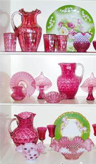 Wonderful display of cranberry glass and porcelain.