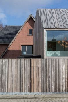 "Declerck-Daels Architecten has used different varieties of timber and ""frivolous"" colours for this dentist surgery in Bruges. House Cladding, Timber Cladding, House Facades, Houses Architecture, Interior Architecture, Wooden Facade, Small Buildings, Facade Design, Bruges"
