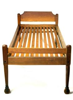 "Bed, cherry and pine, original natural and red stained finish, inset pine slat support, maple and cast iron wheels, New Lebanon, NY, c. 1850, headboard 34"" h, 36"" w, footboard 28 3/4"" h, 36"" w, 76"" l, 32"" w (inside measurements)"