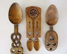 Welsh love spoons. The carving of Love Spoons is a centuries old tradition in Wales. Young men used to lovingly carve a spoon from one piece of wood to give to their loved one. Symbols of love such as hearts, Celtic knotwork, bells and horseshoes were intricately carved to create beautiful and lasting gifts.