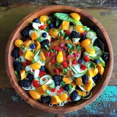 A most beautiful salad. Butter lettuce, arugula, zucchini noodles, red bell peppers, yellow pear tomatoes, blackberries, blueberries, and ataulfo mangos. Dressing is made of mangos, red bell peppers, arugula, ginger and green onion.