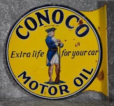 """Flanged Conoco Motor Oil sign for """"Extra Life For Your Car."""""""