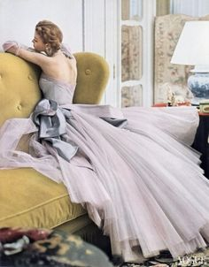 Model Jean Patchett in a ball dress by Jean Dessès. Photographed by Norman Parkinson for Vogue, the April 1, 1950 issue.