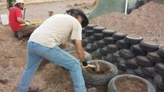 Building a tire retaining wall.