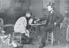 Photograph of Toulouse-Lautrec and Lucién Metivet drinking absinthe, c.1885.