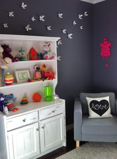 Great example of how charcoal gray can work perfect in a nursery! {Plus, love the hot pink cuckoo clock} #nursery
