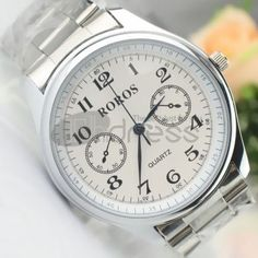Small white dial steel strip watch