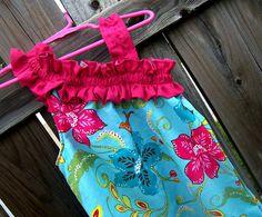 Girl's one-shoulder tropical Aline dress.