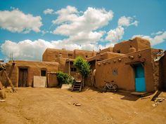 Turquoise Sky at Taos Pueblo, New Mexico.  Go to www.YourTravelVideos.com or just click on photo for home videos and much more on sites like this.
