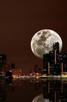 Wow.  I saw the moon look like this as I drove into London one evening. Amazing.