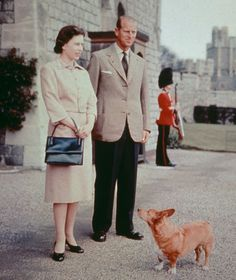 Queen Elizabeth II and Prince Philip with one of their corgis at Windsor Castle in Berkshire, 1959