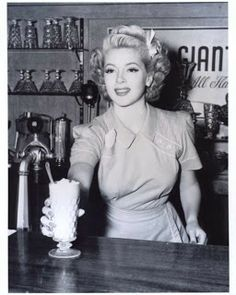 Glamorous diner waitress, love the outfits they wore.