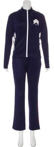 Navy blue and multicolored Perfect Moment Chevron bomber jacket and track pants. Chevron bomber jacket with long sleeves and zip closure at front. Track pants with tonal stitching and elastic waistband featuring drawstring closure. Athletic Pants, Chevron, Track, Bomber Jacket, Sweatpants, In This Moment, Suits, Long Sleeve, Jackets