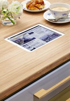 "And by ""haute"" we mean high-tech, geek chic kitchen tables with iPad cutouts."