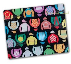 Jockey Silks Cutting Board. Choice horse racing choice gift for this holiday season. Festive design on tempered glass. will look new for years in your kitchen without cracks, chips, scratched or cut marks. Board can be used as a counter saver for hot casseroles or off-the-stove pots and pans. Made in the USA.