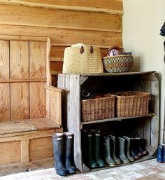 Cool mudroom. Love the paneling, flooring, and of course, the Wellie family :-)