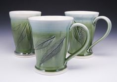 Mugs using real leaves as imprints. As usual, I love the green and blue!